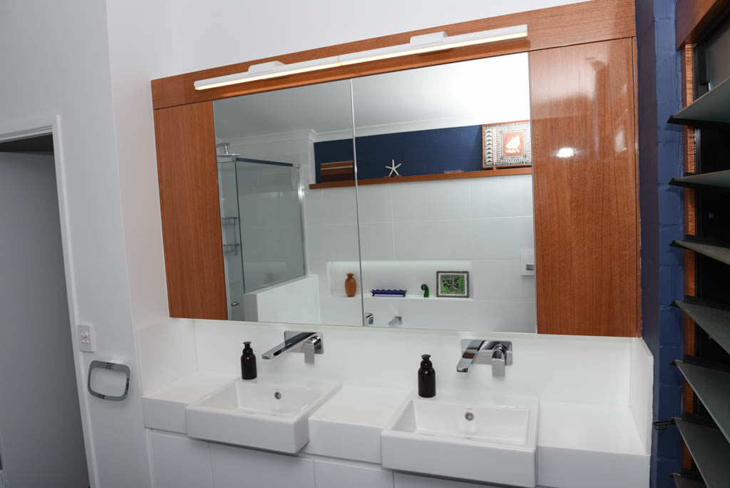 Renovated Bathroom Featuring Corian Benchtops And Bespoke Cabinetry Made From Natural Finish Silky Oak