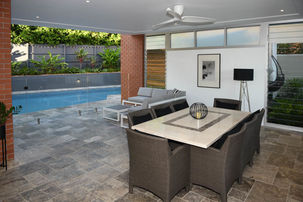 Covered Entertaining Area Overlooking Pool Through Glass Fence